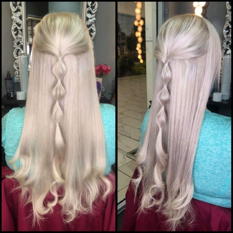 Tape hair extensions by Carla