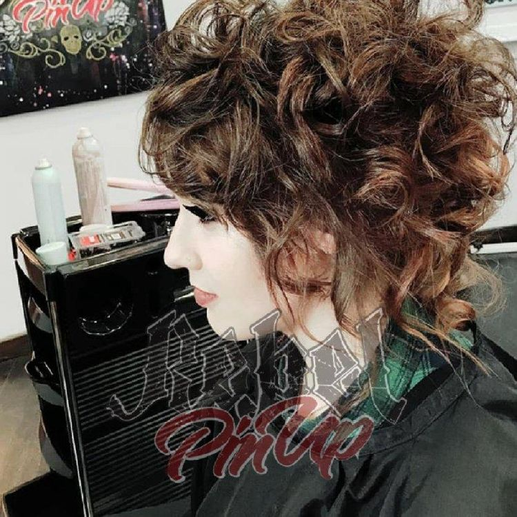 Messy gothic up do for a Prom.